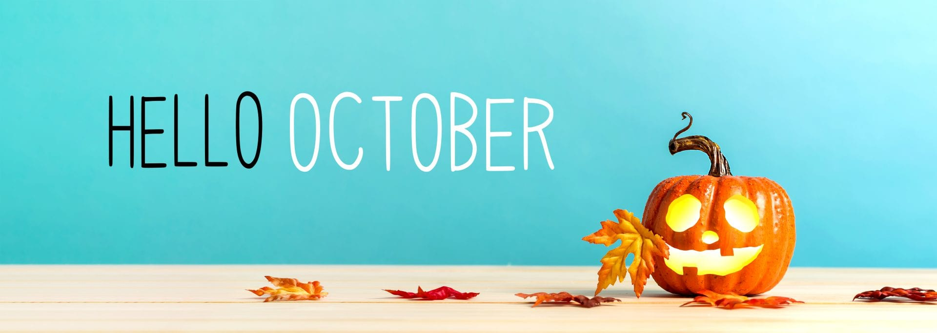 Hello October messag with pumpkin with leaves on a blue background